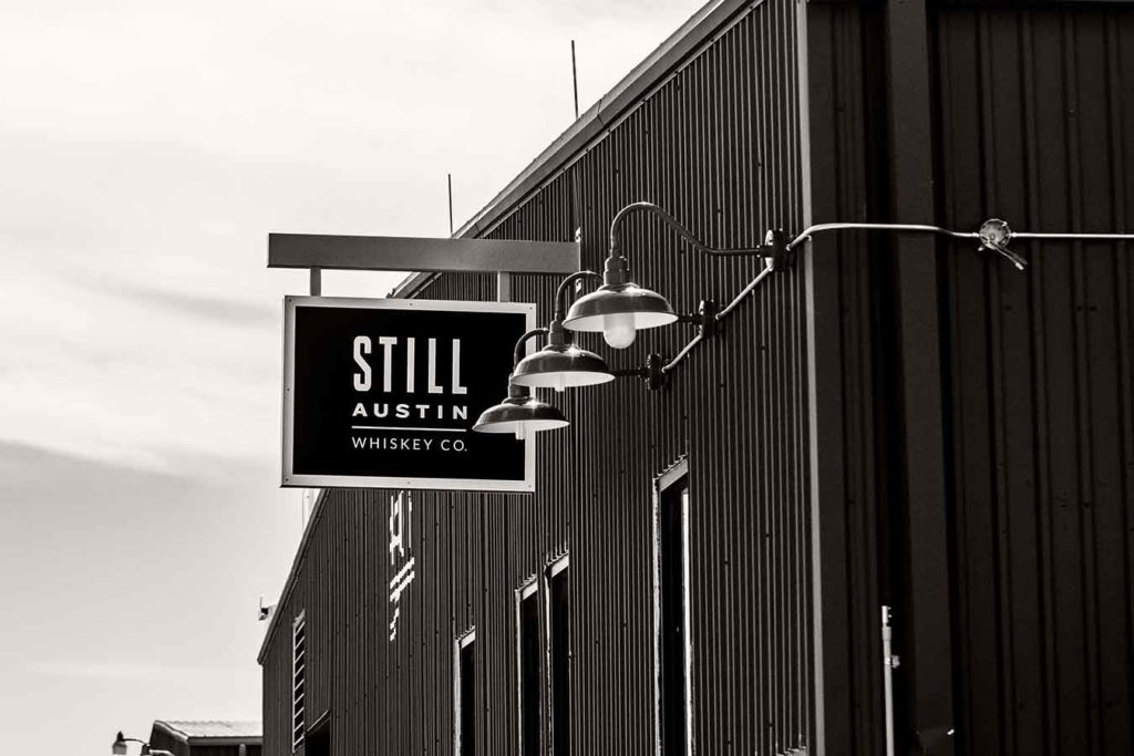 exterior of the still austin whiskey co distillery in austin texas