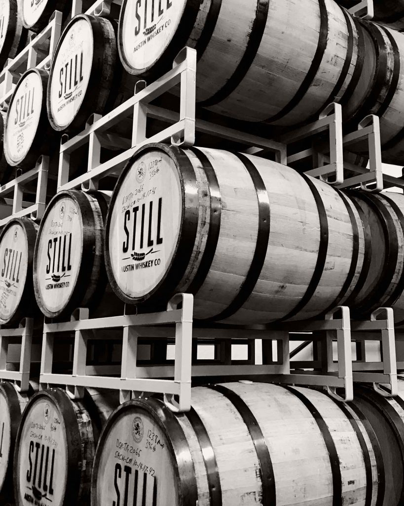 barrels of aging whiskey at the still austin whiskey distillery in austin texas