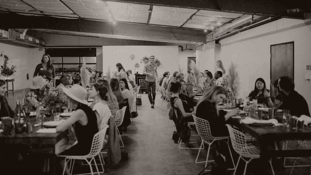 dinner party guests at the site atx event space in austin texas