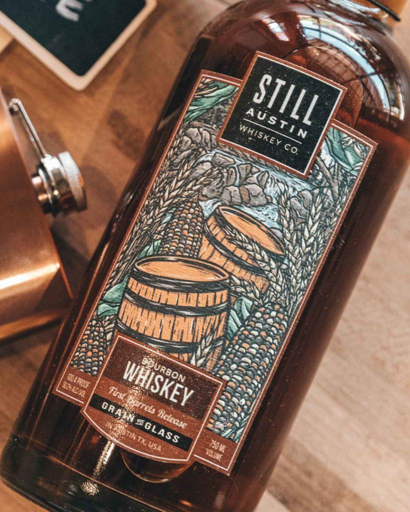 close up of bottle of still austin whiskey made in austin texas